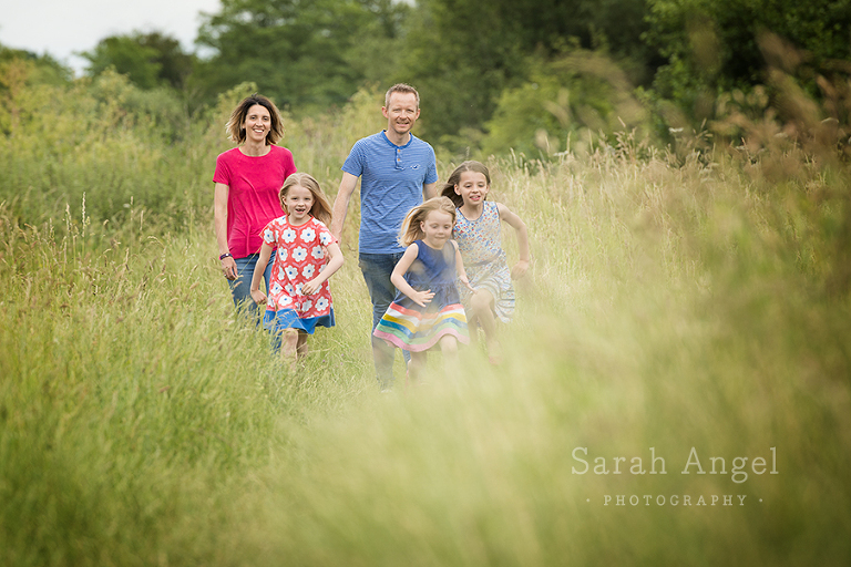 The O'Hare family take a short break from their busy weekend for their Photo Shoot in the meadows near St Andrew's Church in Farmham.
